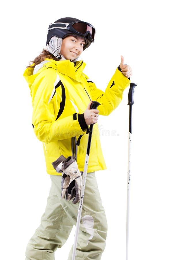 Weiblicher Skifahrer, der Daumen bildet stockfoto