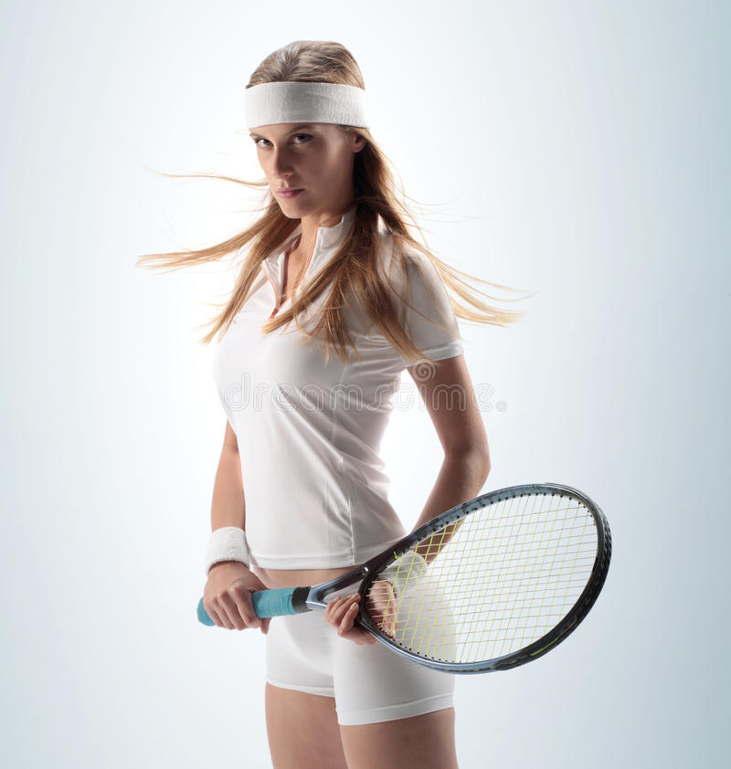 Weiblicher Tennis-Spieler stockfotos