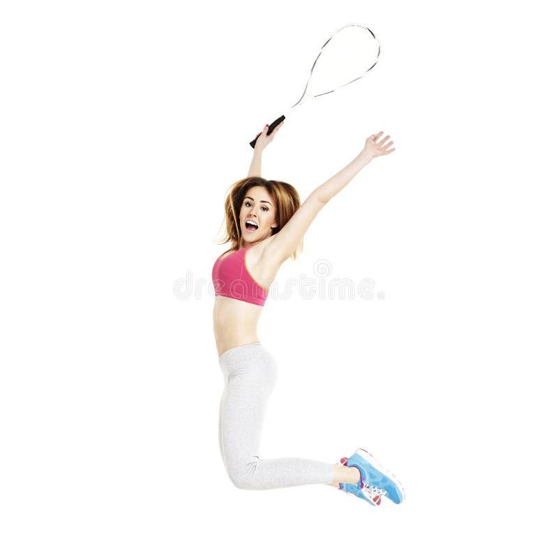 Weiblicher Tennis-Spieler springt oben stockbild