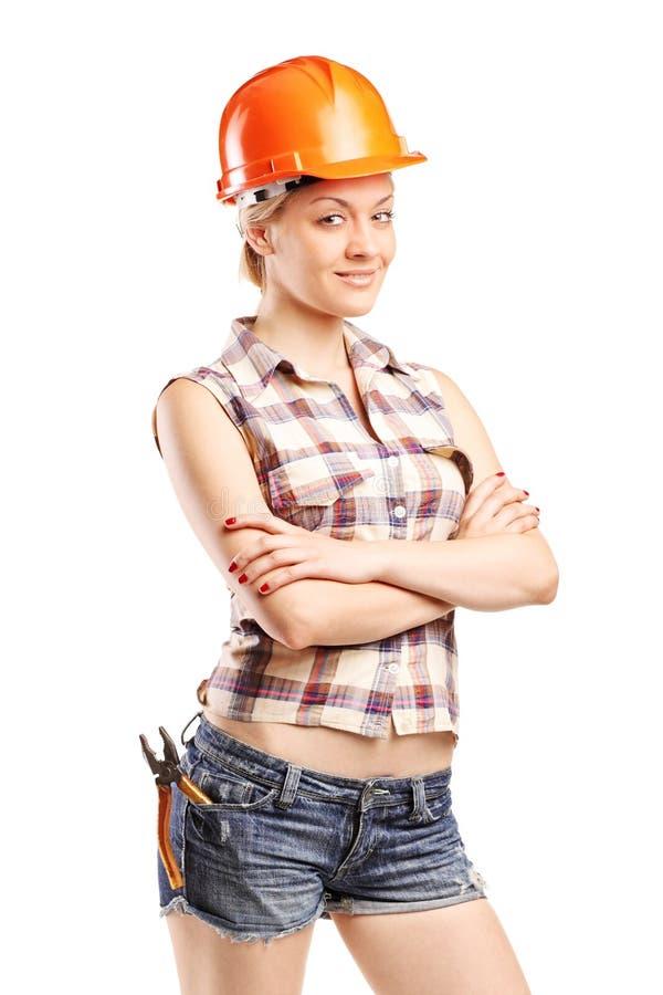 Weiblicher Tischler mit einem orange Sturzhelm lizenzfreie stockfotos