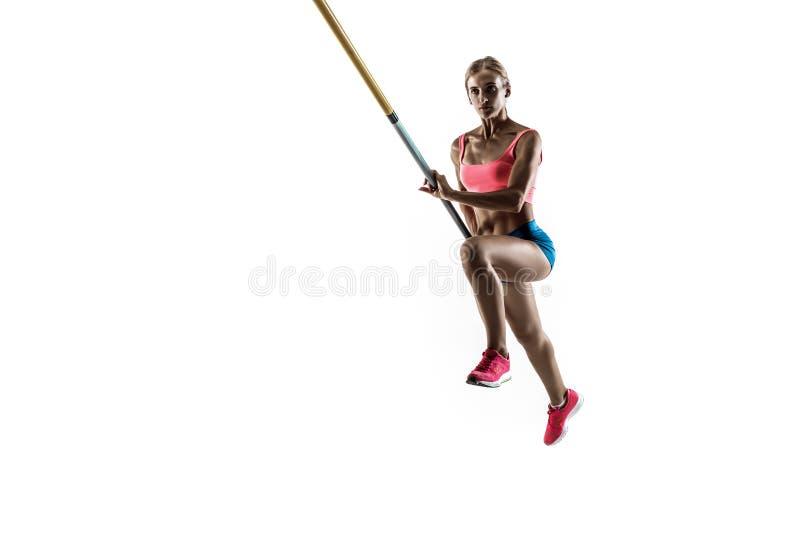 Weibliches Stabhochspringertraining auf weißem Studiohintergrund lizenzfreies stockfoto