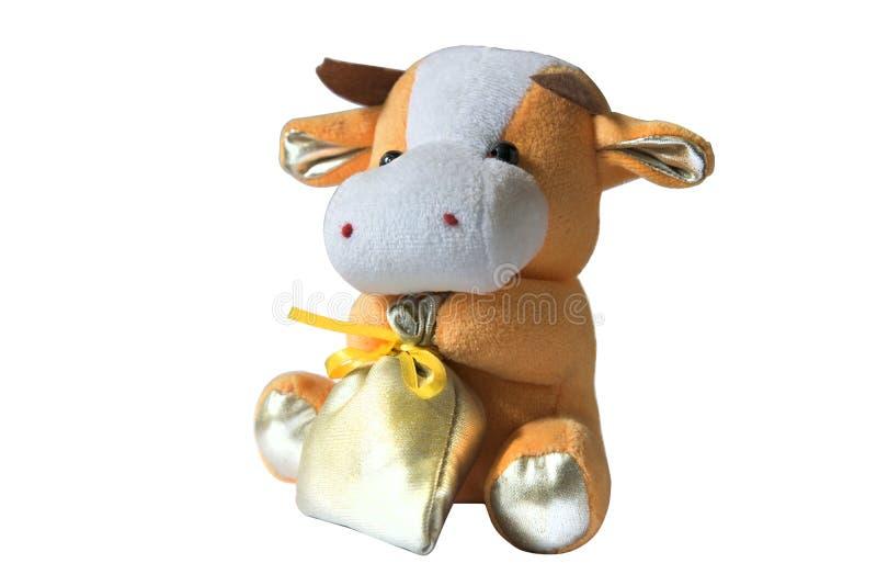 Weiches Spielzeug der Kuhtasche lokalisiert auf Weiß stockfoto