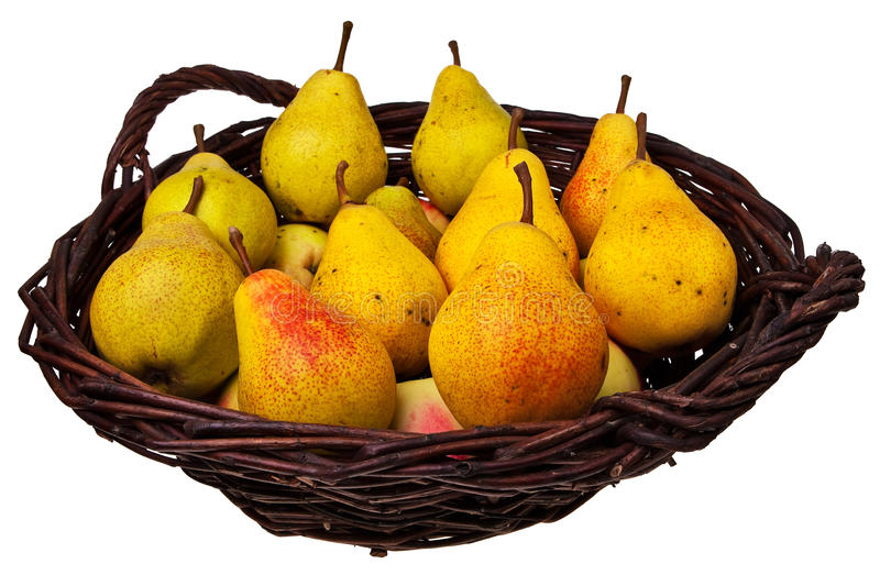 Weidenstockkorb mit Birnen und Äpfeln. stockfotografie