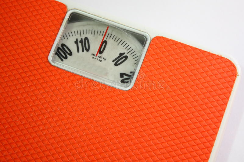 Weigh Scale. Closeup of scale showing around 0 kg stock images