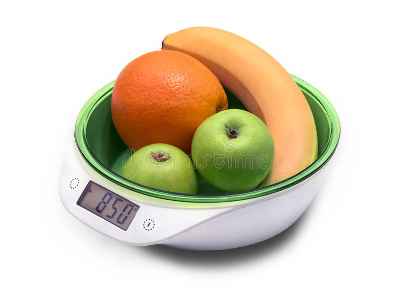 Weighing fruit for diet on electronic scales. isolated on white stock images