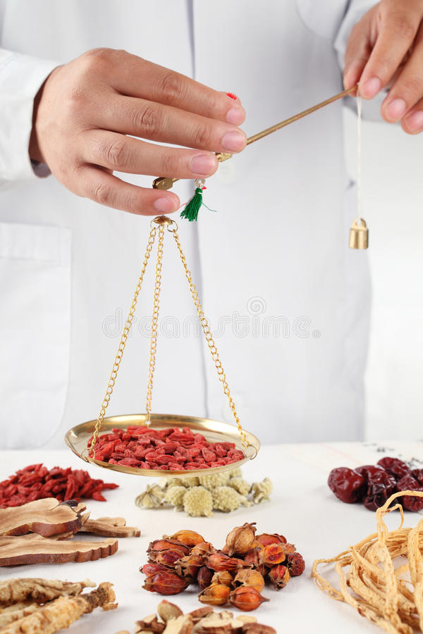 Weighing medicinal herbs royalty free stock photos