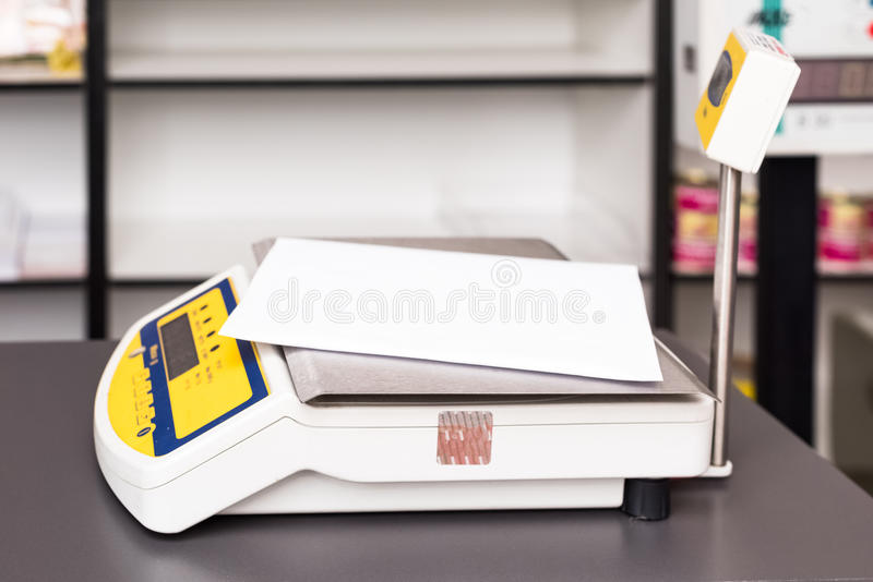 Weighing package at the post. Office royalty free stock photo