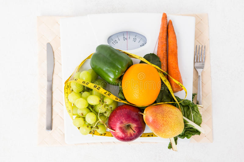 Weighing scales with fruits and vegetables stock photos