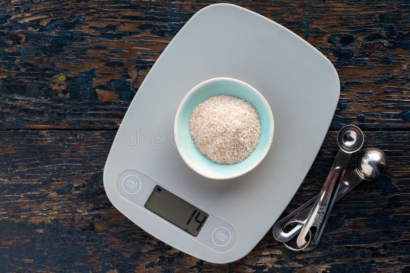 Weighing Spelt Flour on a Digital Scale stock images