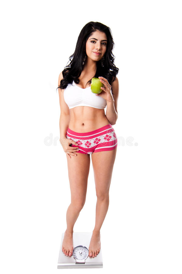Weight Concious Woman With Apple Royalty Free Stock Photo