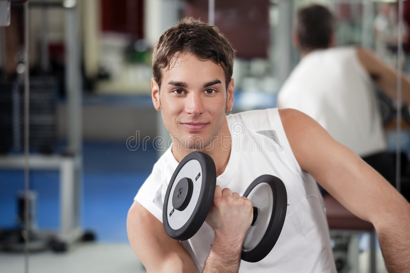 Download Weight lifting stock image. Image of biceps, body, indoors - 8215901
