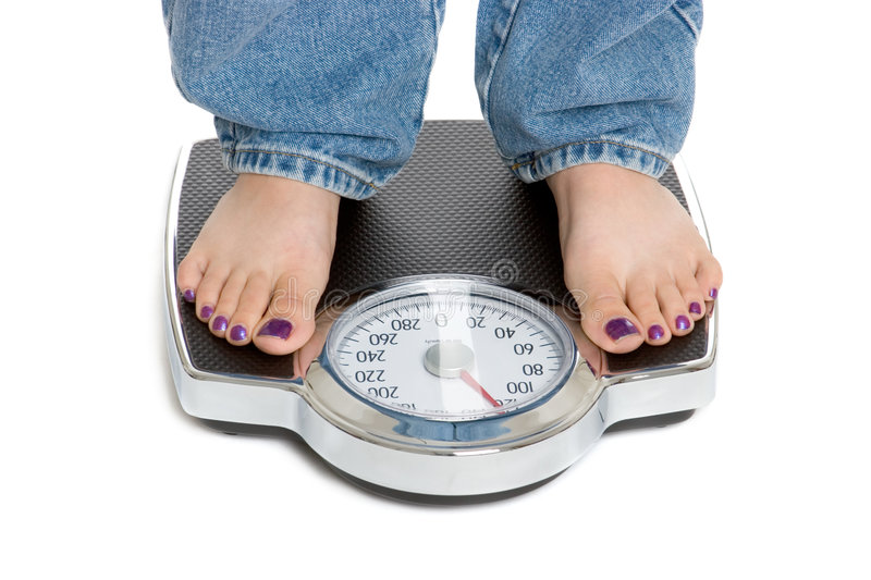Weight Loss. Standing on scale weight loss royalty free stock photo