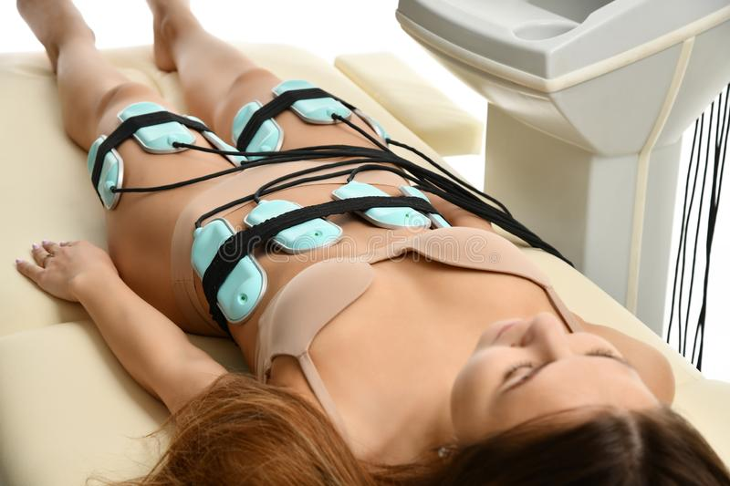 Weight loss anti cellulite anti fat therapy concept. Massage for female abs, buttocks and legs in beauty salon. Body care. Ultrasound deep cavitation body stock photo