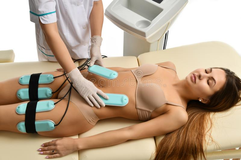 Weight loss anti cellulite anti fat therapy concept. Massage for female abs, buttocks and legs in beauty salon. Body care. Ultrasound deep cavitation body stock image
