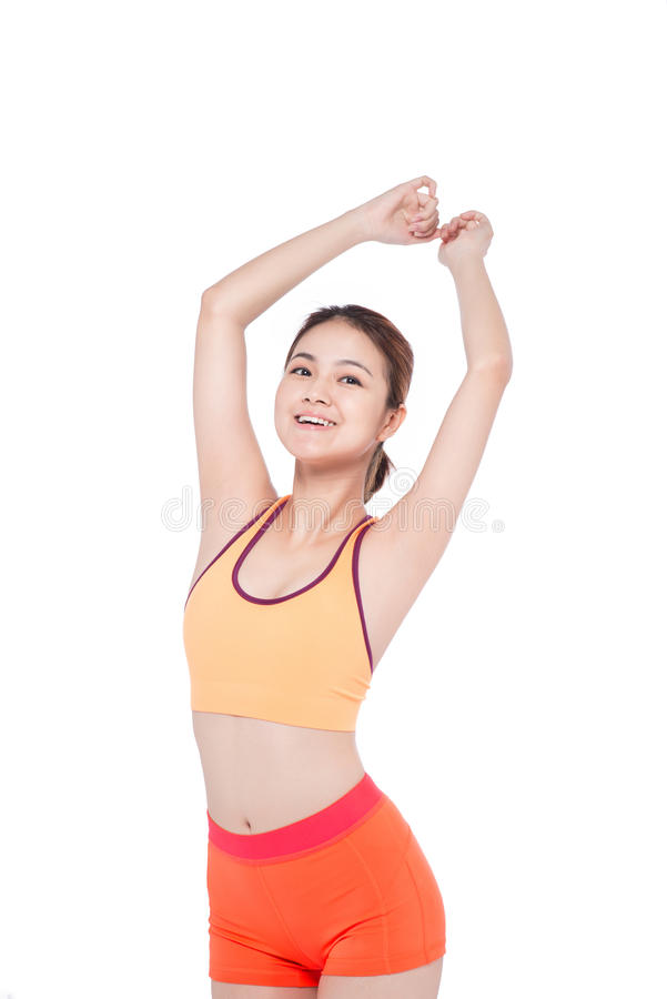 Weight loss concept. Cheerful young exercising woman, isolated o royalty free stock photos