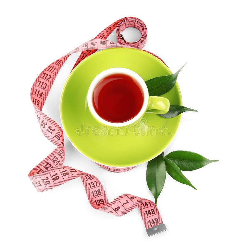 Weight loss concept. Cup of tea and measuring tape isolated. On white stock image