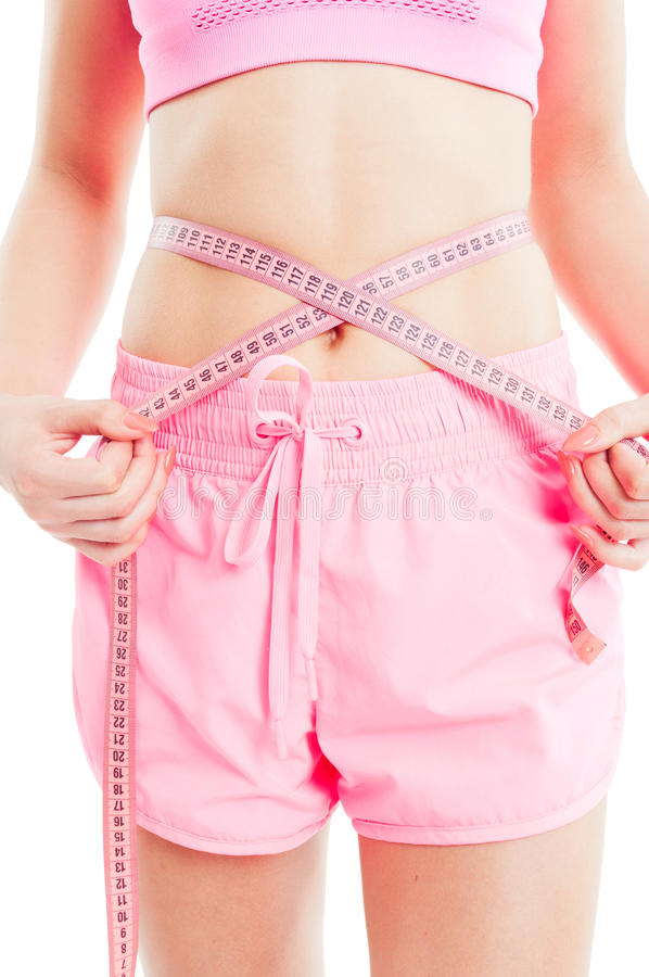Weight loss concept with woman measuring waist. Using a meter tape or ruler stock photo