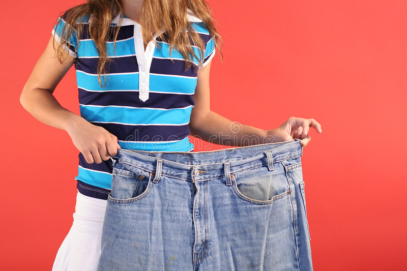 Weight loss fat jeans royalty free stock photo