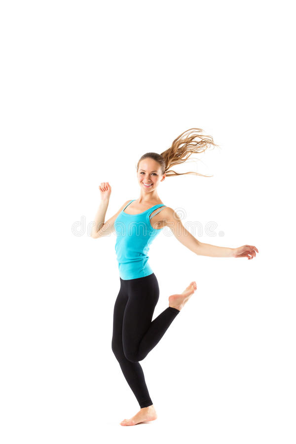 Weight loss fitness woman jumping of joy. royalty free stock image