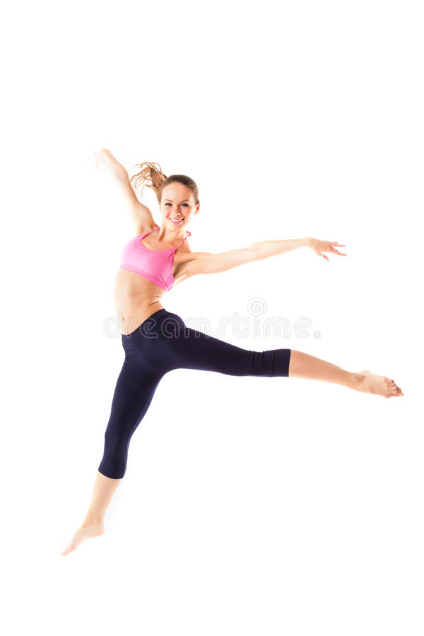 Weight loss fitness woman jumping of joy. Young sporty Caucasian female model isolated in full body royalty free stock images