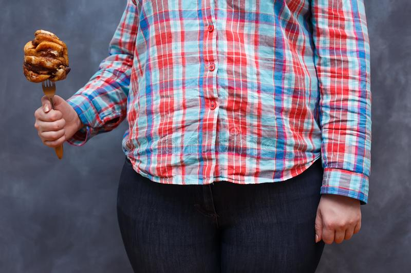 Weight loss, junk food, overweight, dieting, food addiction conc stock photos