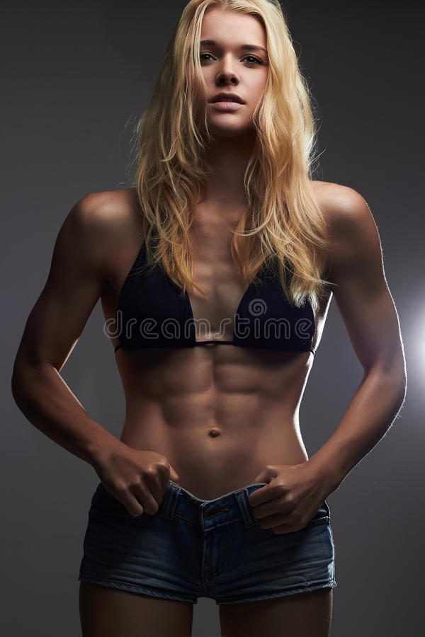 Weight loss.sexy beautiful thin girl in jeans shorts royalty free stock image