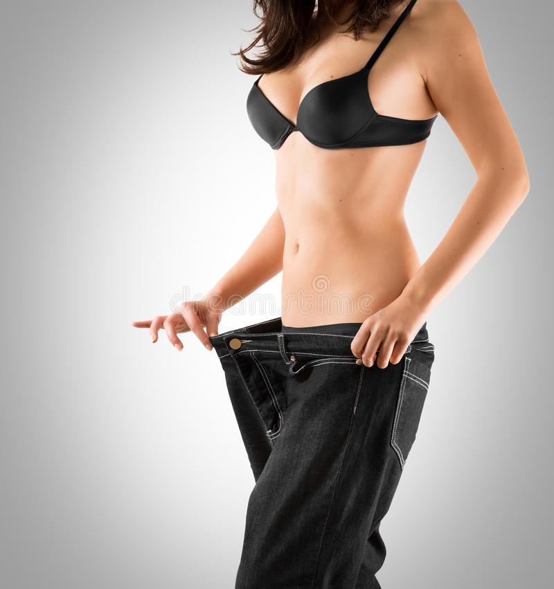 Weight loss. With slim waist stock images