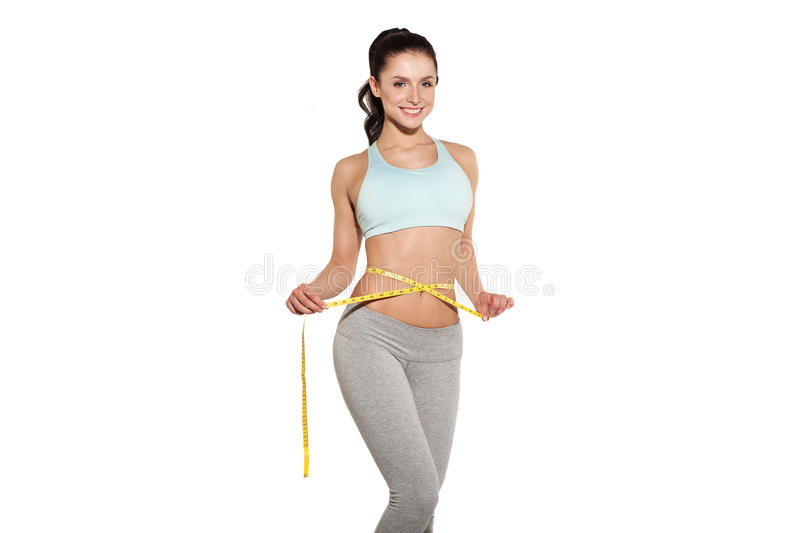 Weight loss, sports girl measuring her waist. Training in the gym, workout abdominals stock images