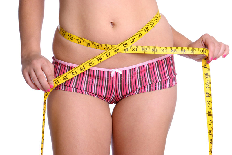 Weight Loss Woman. Measuring waist royalty free stock photography