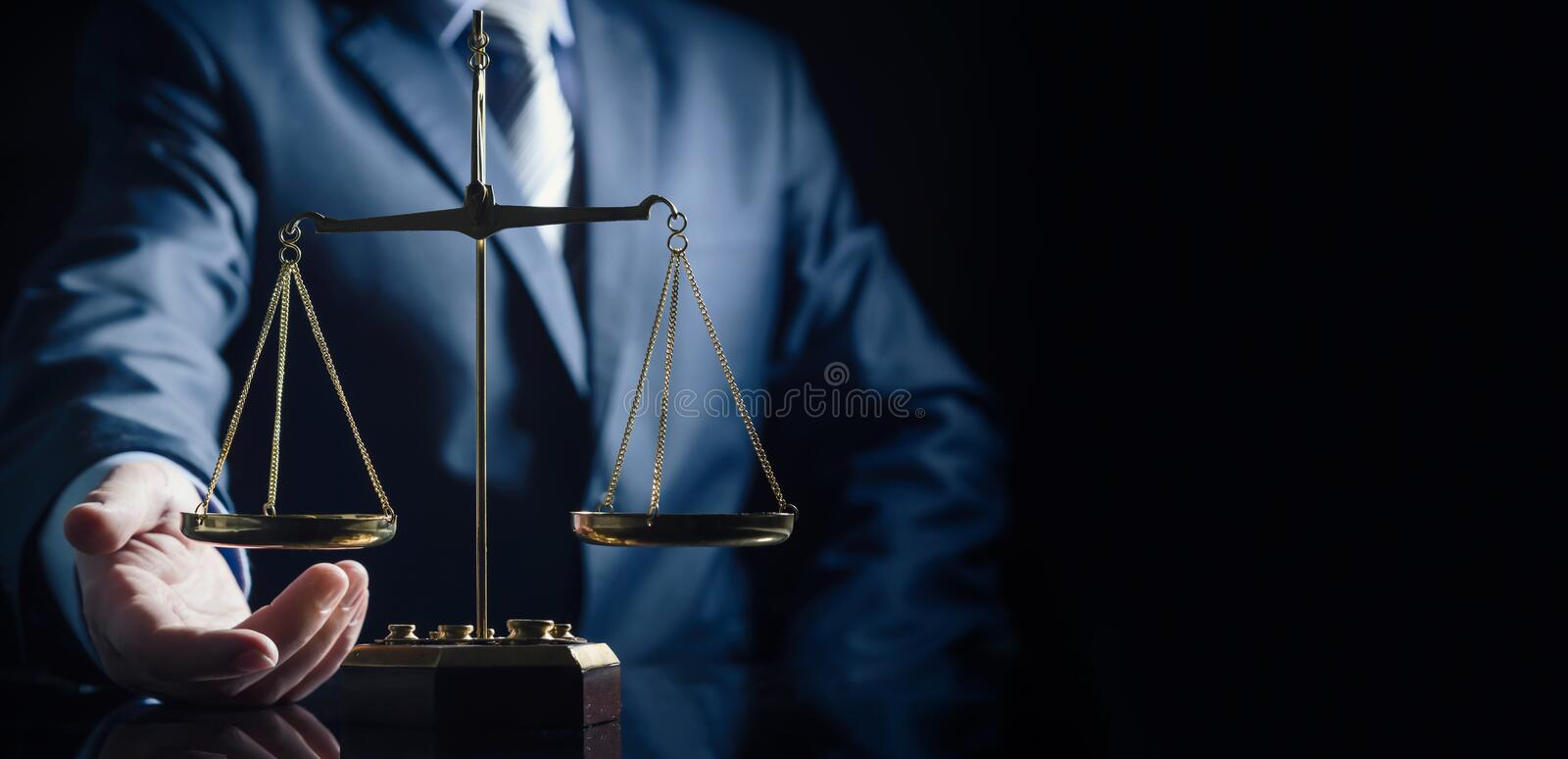 Weight scale of justice, lawyer in background stock image