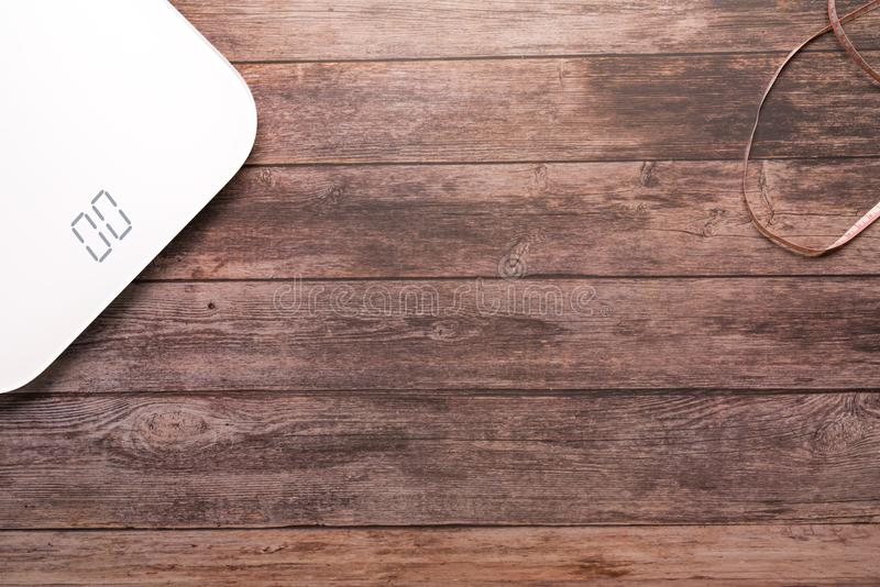 Weight scale white digital with measuring tape on the wooden backgrounds health and fitness life concept royalty free stock images