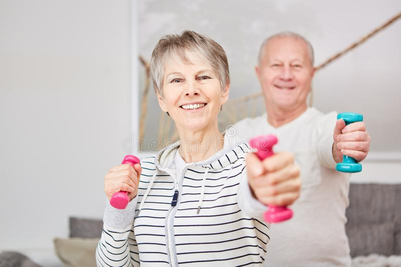 Weight training for seniors royalty free stock photos