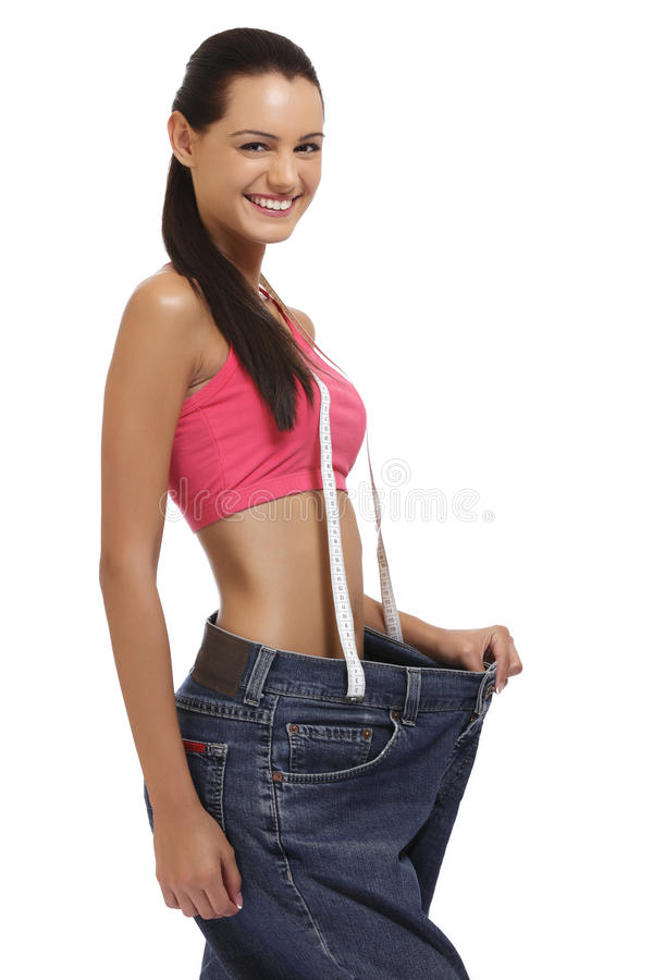 Weightloss begreppslady som visar bantning på white royaltyfria bilder