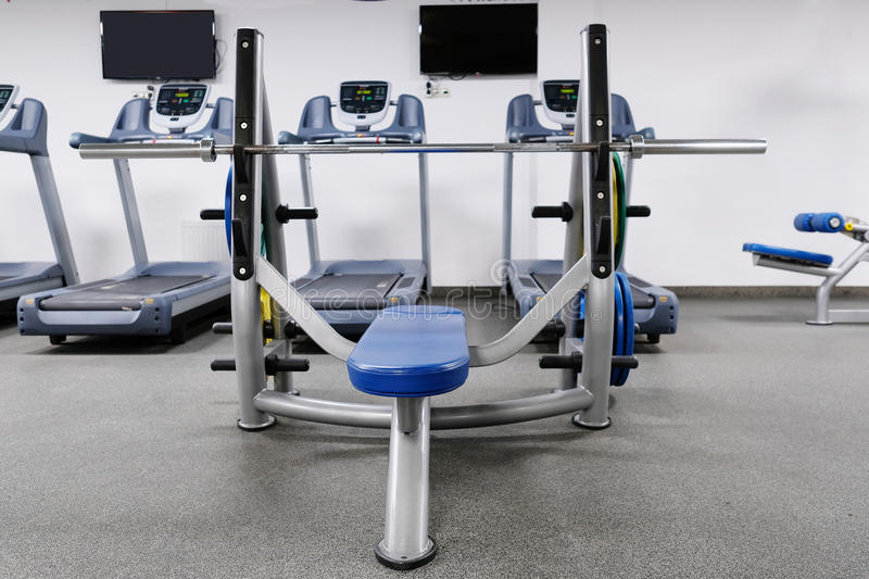 Weights in a fitness hall. The image of weights in a fitness hall stock photo