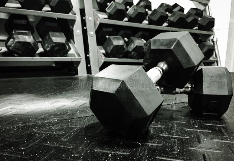Weights on the Gym Floor. Black and white picture of weights on the gym floor stock photos