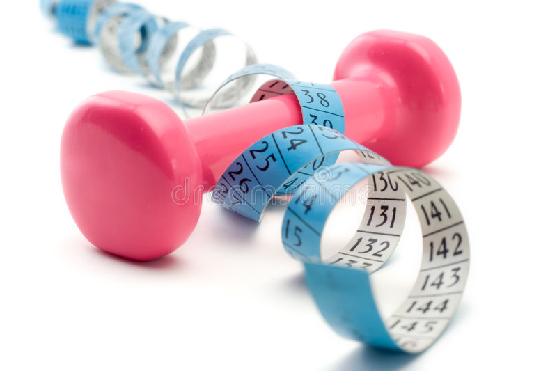 Weights wrapped around a measurement tape stock photo