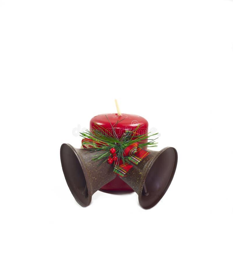 Weihnachten Bell und rote Kerze stockfotos