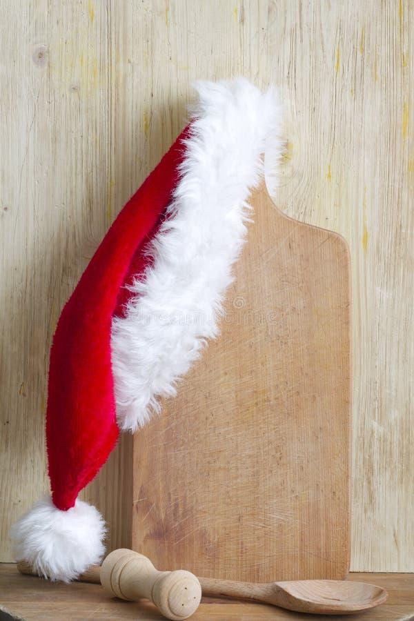Weihnachten, das abstrakten Hintergrund mit Weihnachtsmann-Hut kocht stockbild