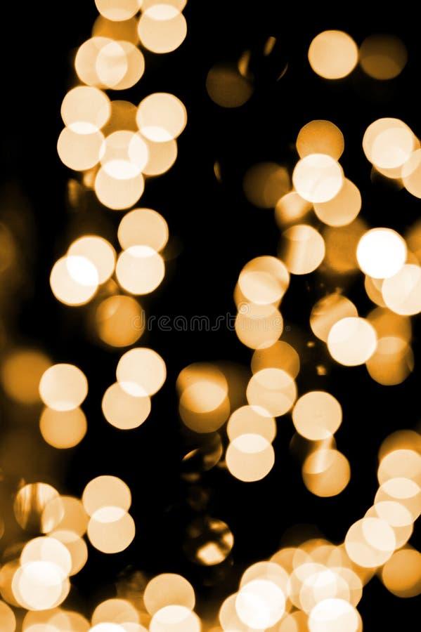 Weihnachts-Hintergrund, Weihnachts-Lichter, Gold-bokeh stockbilder