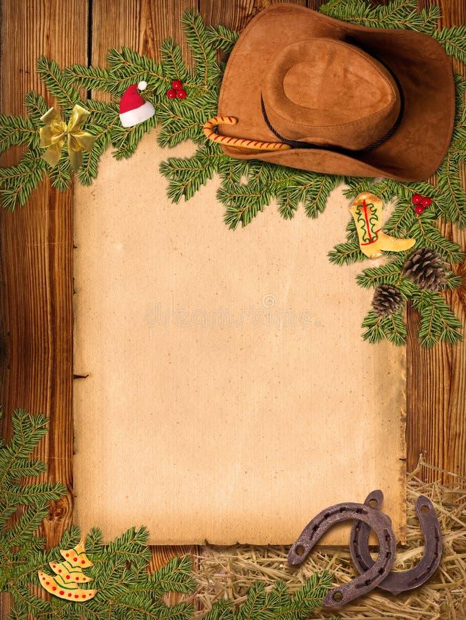 Weihnachtsamerikanischer Westhintergrund mit Cowboyhut und altem PA lizenzfreie abbildung