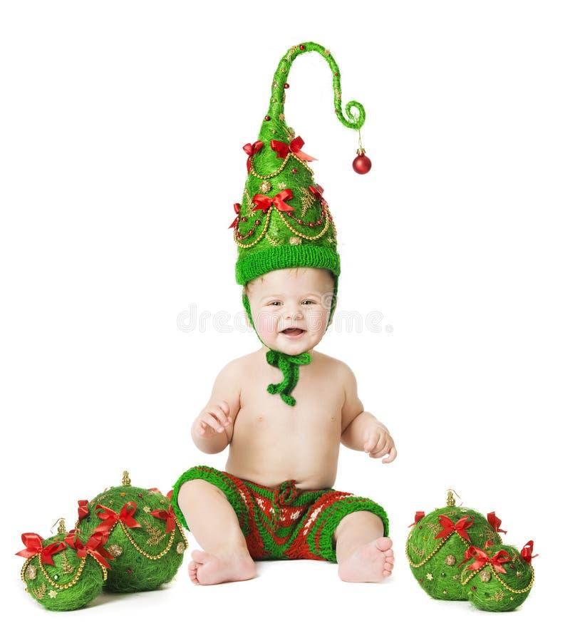 Weihnachtsbaby, Weihnachtsbaum-Hut, Kinderball-Spielwaren auf Whhite stockbild