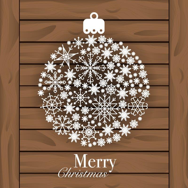 Weihnachtsball gemacht von den Schneeflocken lokalisiert auf hölzernem Hintergrund stock abbildung