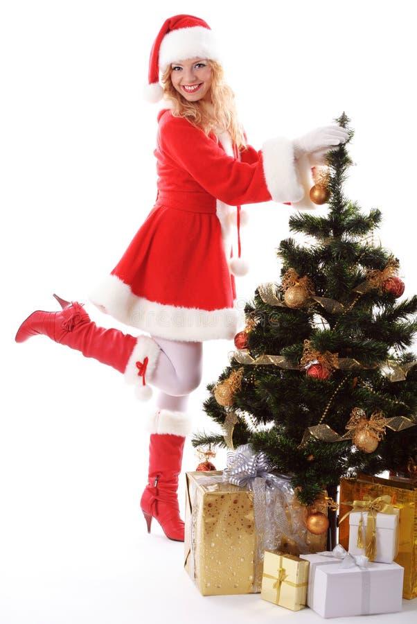 Weihnachtsbaum und Sankt-Mädchen lizenzfreies stockbild
