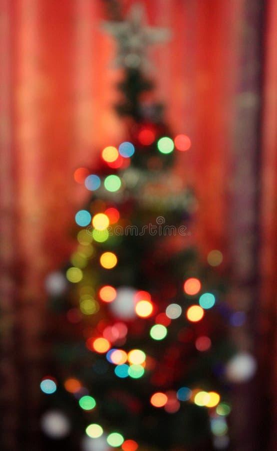 Weihnachtsbaum-undeutliche bunte Lichter lizenzfreies stockfoto