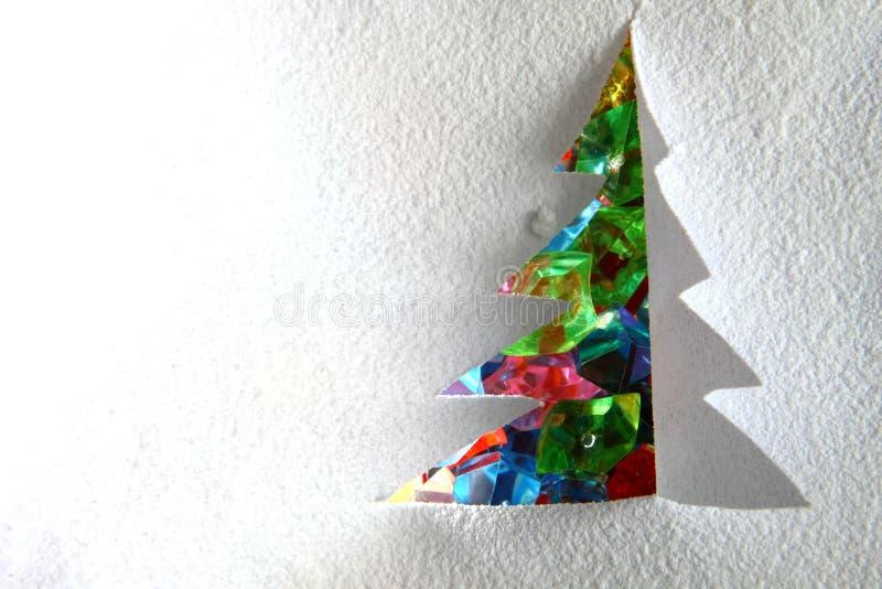 Weihnachtsbaum vom Papier und vom Schnee stockfotos