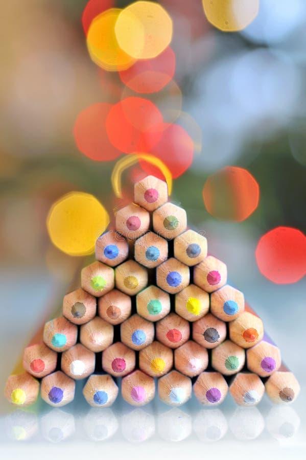 Weihnachtsbaumbleistifte und -lichter stockfotos