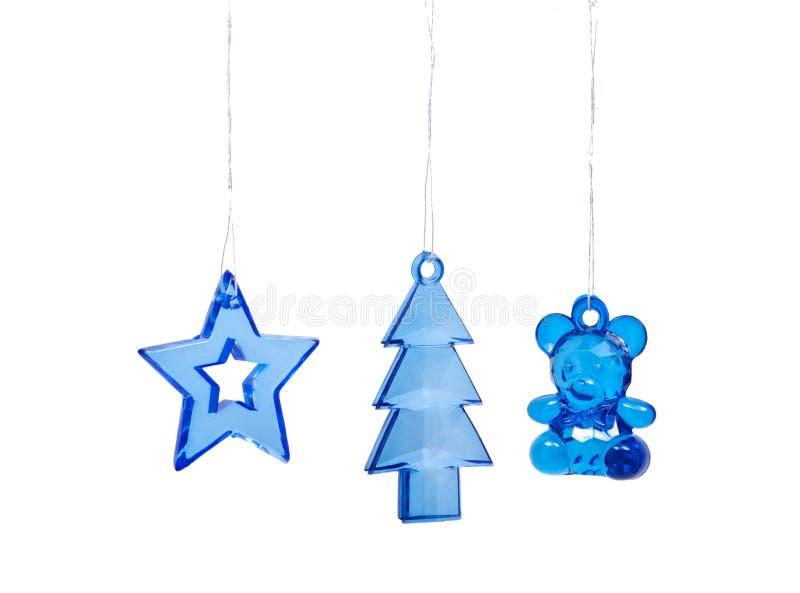 Weihnachtsbaumspielwaren auf weißem Hintergrund stockbild