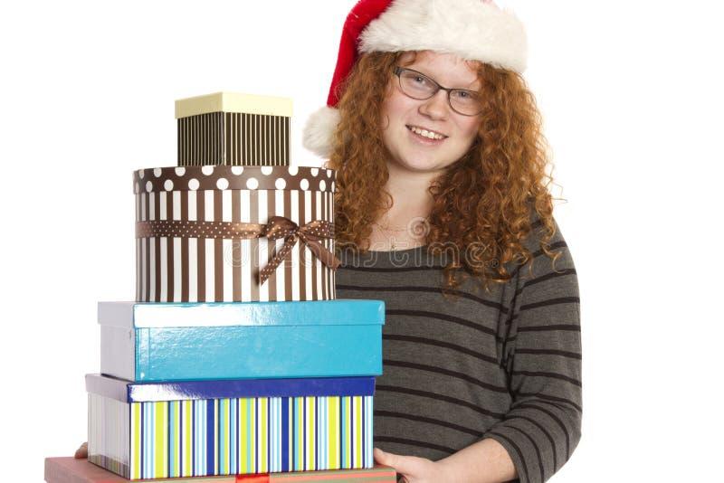 Weihnachtsbeifall und -geschenke in einem Stapel lizenzfreie stockfotos