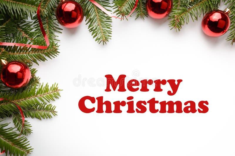 Weihnachtsdekorationen mit dem Weihnachtsgruß ` frohe Weihnachten ` stockbilder