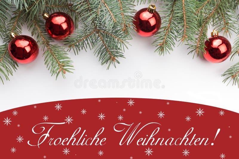 Weihnachtsdekorationen mit Weihnachtsgruß im deutschen ` Froehliche Weihnachten! ` stockbilder